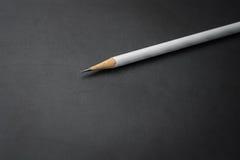 Matita bianca sul nero Immagini Stock Libere da Diritti