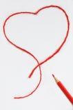 Matita e un cuore rosso Fotografia Stock Libera da Diritti