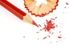 Matita rossa con i trucioli della matita fotografia stock