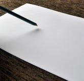 Matita su Libro Bianco Fotografia Stock Libera da Diritti