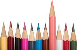 Matite colorate con una matita rosa che sta fuori Immagini Stock Libere da Diritti
