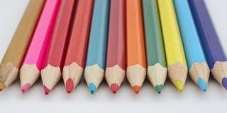 Matite colorate del banco Immagini Stock