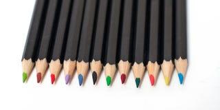 Matite colorate del banco impilate Illustrazione di Stock