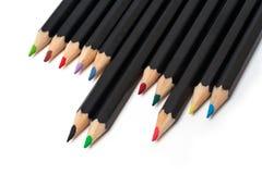 Matite colorate del banco impilate Immagini Stock Libere da Diritti