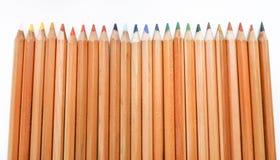 Matite colorate di legno su fondo bianco Fotografia Stock Libera da Diritti