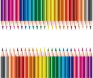 Matite colorate nelle righe illustrazione di stock