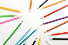 Matite colorate su bianco Fotografie Stock