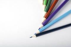 Matite colorate su documento Immagini Stock Libere da Diritti