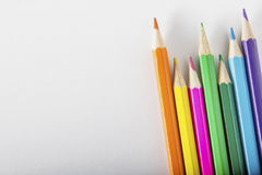 Matite colorate su documento Fotografie Stock