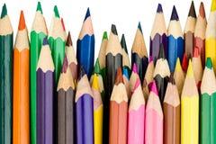 Matite colorate in una fila diritta Fotografia Stock