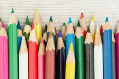 Matite colorate in una riga Fotografia Stock