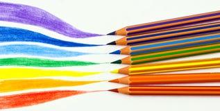 Matite di colore e un Rainbow Fotografia Stock Libera da Diritti