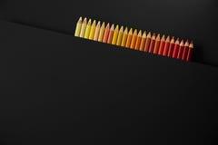 Matite di colore su un fondo nero Fotografie Stock Libere da Diritti