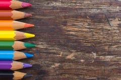 Matite di colore su una tavola di legno Fotografia Stock Libera da Diritti