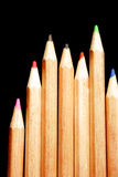 Matite di colore sui precedenti neri Immagine Stock Libera da Diritti
