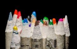Matite di coloritura sul nero immagine stock libera da diritti