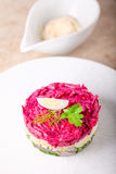 Matjes herring tartare on a white plate.  Royalty Free Stock Photography