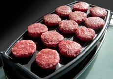 Matkött - nötkötthamburgare Arkivfoton
