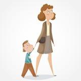 Matka, syna mienie i odprowadzenie ręki i postać z kreskówki śmieszni Zdjęcie Royalty Free