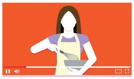 Matlagning för ung kvinna på internetvideoen royaltyfri fotografi