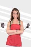 Matlagning för ung kvinna, studioskott royaltyfria bilder