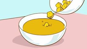 matlagning Krutonger för en tecknad film som faller in i soppan Royaltyfri Foto