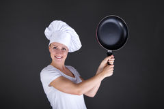 Matlagning- och matbegrepp - le kvinnliga kock-, kock- eller bagarewi royaltyfria foton