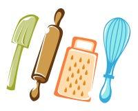 Matlagning och stekheta kökhjälpmedel Arkivbild