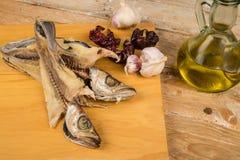 Matlagning torkad fisk Fotografering för Bildbyråer