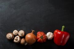 Matlagningbakgrundsgrönsaker royaltyfria bilder