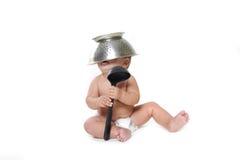Matlagningbarnet behandla som ett barn över white Royaltyfri Bild