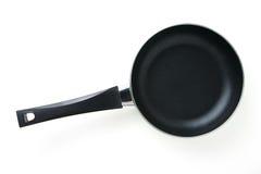 matlagningutrustning som steker isolerad pannawhite Arkivbilder