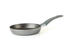 matlagningutrustning som steker isolerad pannawhite Arkivfoto