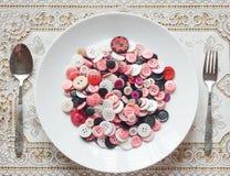 Maträtt av knappar Royaltyfria Bilder