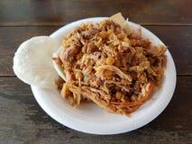 Maträtt av lechonaen, en traditionell mat från espinalen, tolima, Colombia över en wood tabell royaltyfri foto