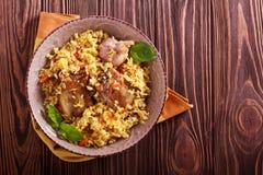 Maträtt för grisköttstöd och ris royaltyfri bild