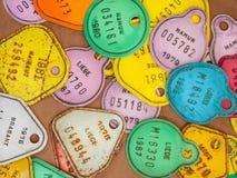 Matrículas coloridas velhas do imposto da bicicleta Fotografia de Stock