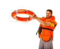 Maître nageur dans le gilet de vie avec la bouée de sauvetage de balise d'anneau Images libres de droits