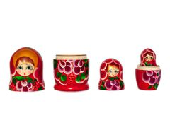 Matreshka Russian doll souvenir bright red, purple and green flowers pattern on white background isolated closeup stock photos