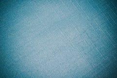 Matéria têxtil sintética com luz - fundo azul da cor Imagens de Stock Royalty Free