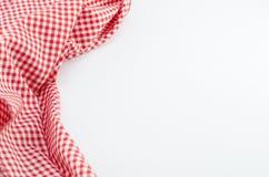 Matéria têxtil vermelha da toalha de mesa no fundo branco Imagens de Stock