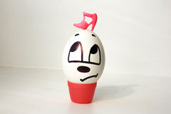 Matriarchy concept. The egg is sad with a painted face Stock Photography