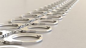 Matrice lineare di cromo Handcuffss su Gray Surface leggero Illustrazione Vettoriale