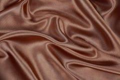 Matériel en soie ou papier peint élégant De de velours de satin de texture de Brown Photographie stock libre de droits