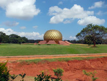 Matrimandir. The Matrimandir is an edifice of spiritual significance for practitioners of Integral yoga and meditation, situated at the centre of Auroville Stock Photography
