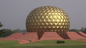 Matrimandir - modern  architecture Golden Temple in Auroville for meditation, India stock footage