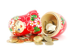 Matrioshka with coins Stock Image