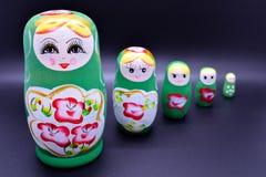 Green russian national Matrioska toy on dark black background royalty free stock photo