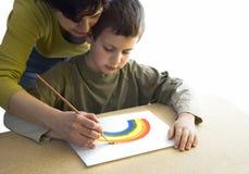 A matriz ajuda o filho isolado Foto de Stock Royalty Free