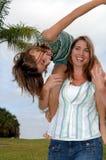 Matriz brincalhão e filha Fotografia de Stock